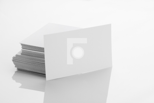 Blank business card mockup on white reflective background objects blank business card mockup on white reflective background reheart