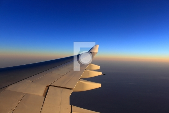 aero plane wing and beautiful evening sky