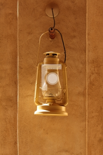 antique arabic lamp lantern with textured wall