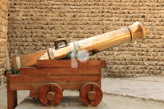 antique gold cannon in dubai museum, united arab emirates