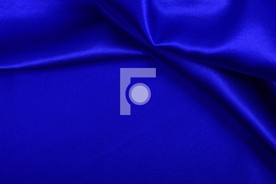 Blue colored satin fabric background