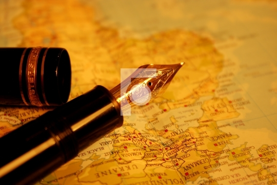 business traveller pen with world map in the background