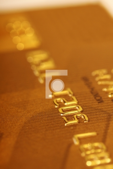 Close up of a gold credit card