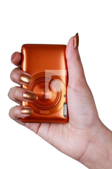 Compact Digital Camera in a Female's Hand