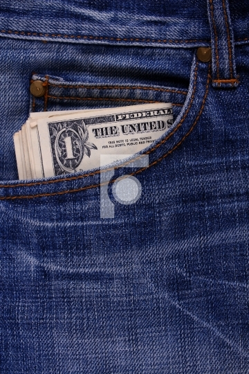 currency notes on a jeans pocket