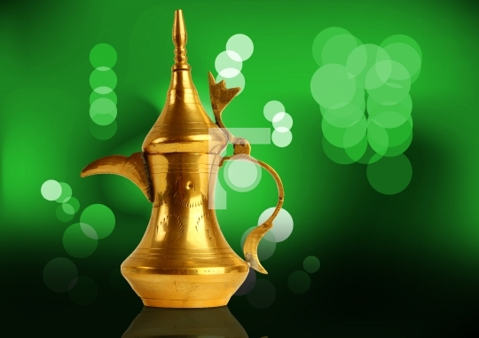 Dallah - the Traditional arabic coffee pot in green light backgr