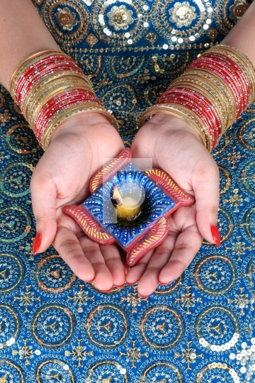 Diwali Celebration Diya on a Female Hand