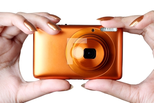 Female taking photo with a digital compact camera