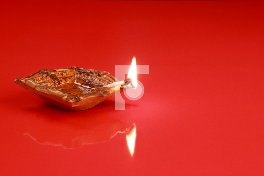 Handmade Diwali Clay Lamp on Red Color Background
