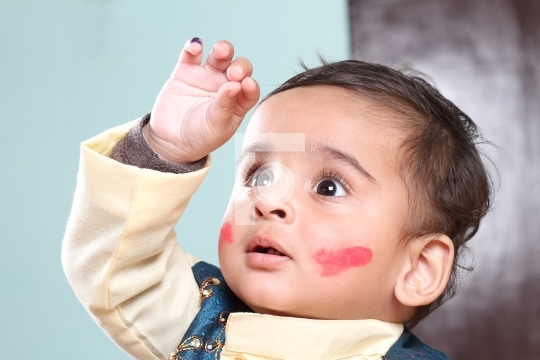 Indian Baby Boy Celebrating Holi with Colour on Face