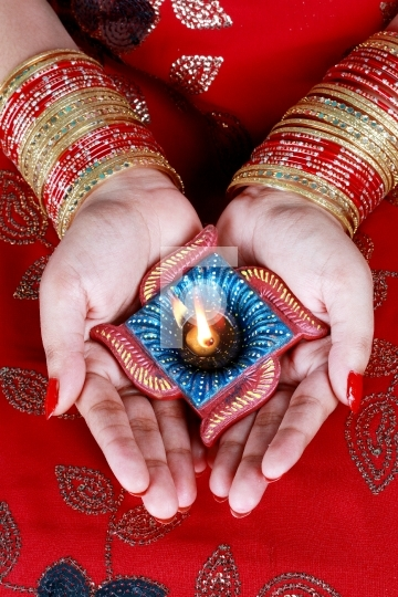 Indian Festival Diwali Diya Lamp in Female Hand