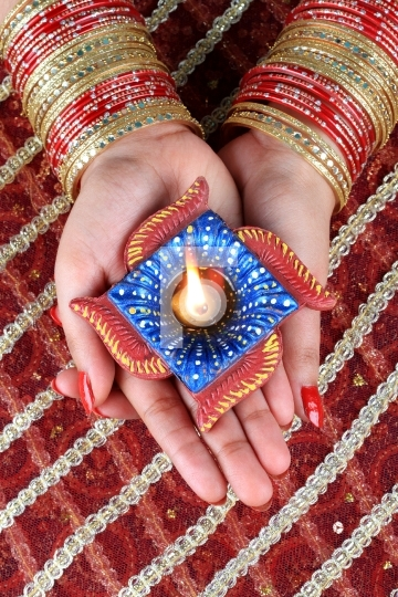 Indian Festival Diwali Diya Lamp Light in Female Hand