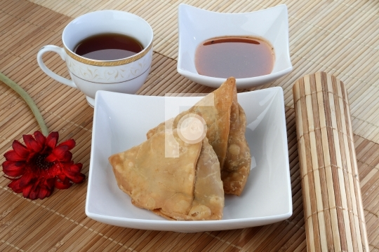 Indian Food Spicy Samosa with Tea and Chutney