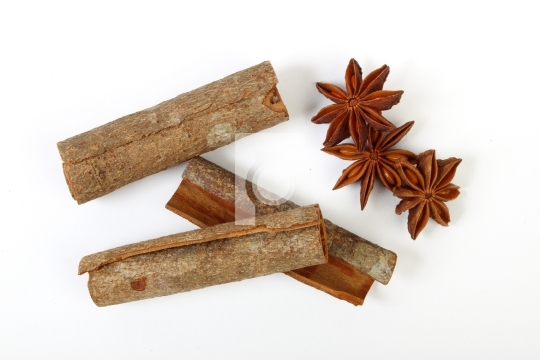 Indian herb star anise and cinnamon in white background