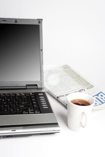 Laptop, Coffee and newspaper