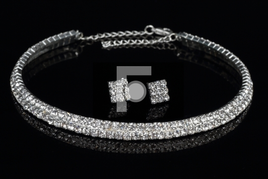 Modern Diamond Necklace and Earrings Jewelry on Black Background