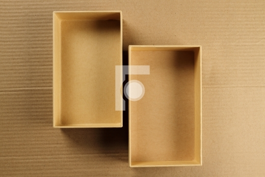 Open Recycled Card Board Box on Corrugated Background