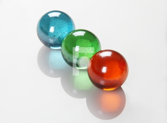 RGB Color Balls / Marbles /Orbs on white Reflective Background
