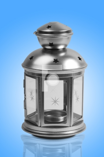 Silver lamp with blue background