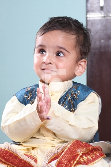 smiling indian baby boy in traditional indian outfit kurta