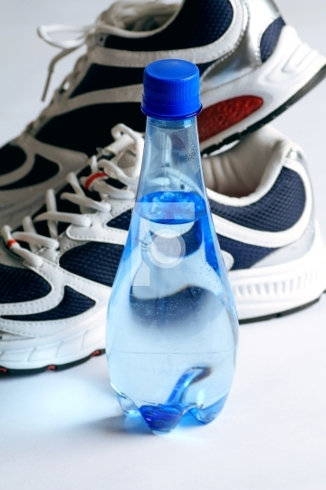 sports shoes and water bottle