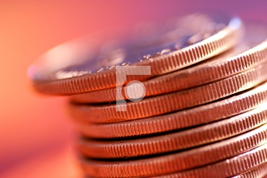 stack of coins with shallow depth of field