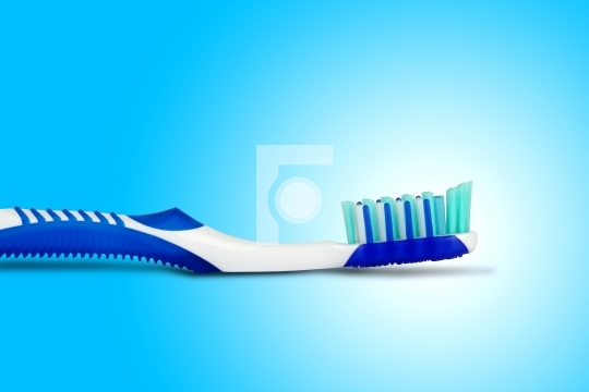 Tooth brush in blue background